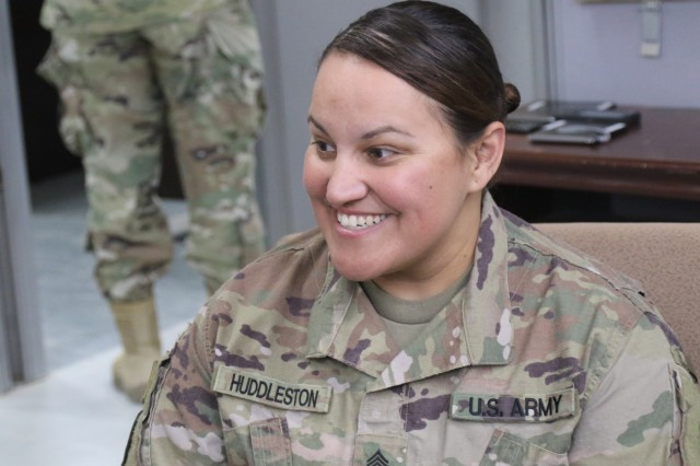 Sgt. Ruthie Huddleston, 450th Transportation Battalion, talks to Soldiers at Holy Joe's, a resilency center at Camp Arifjan, Kuwait, May 20, 2019. (U.S. Army National Guard photo by Sgt. Connie Jones)