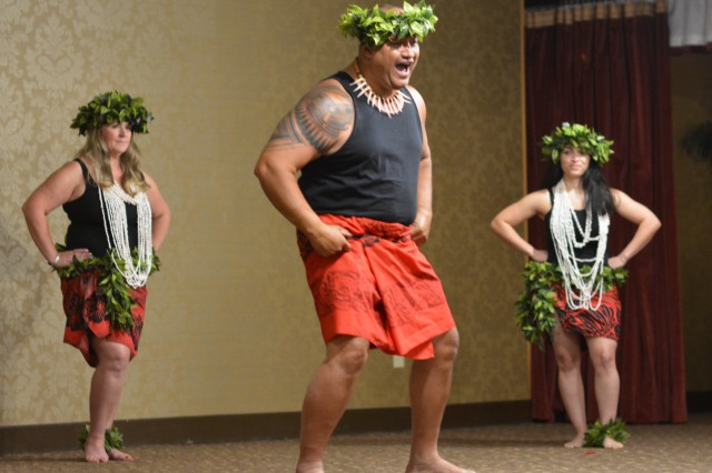 Members of the South Sea Dancers performance group share a bit of their Pacific Islander culture May 17 at the NCO Club with attendees of the Asian American Pacific Islander Heritage Month observance luncheon.