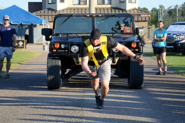 A demonstrator in the 2019 Fort Jackson Strongman/Strongwoman Competition demonstrates good form May 16 to pull a 6,400 pound Hummer.