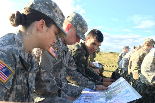 Cadet Claire De Souza, Saint Leo University, and Cadet Ross Martin, Montana State University, prepare to navigate the orienteering course at the Academia Militar das Agulhas Negras, Brazil.