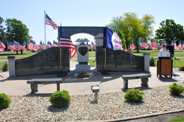 The Iowa Army Ammunition Plant Monument at the Eagle Park Memorial honors the 70 employees who have lost their lives since ammunition production began at the plant in 1941. Randall Kinney, chief of quality assurance, served as the emcee during the annual memorial ceremony on May 23.