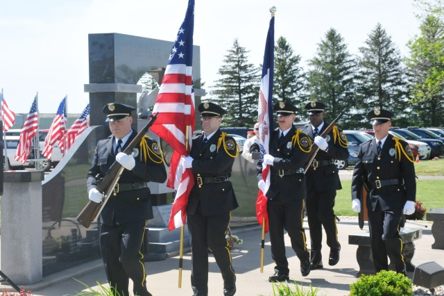 The Burlington, Iowa, Police and Fire Honor Guard retires the colors during the Iowa Army Ammunition Plant's Memorial Ceremony, May 23.