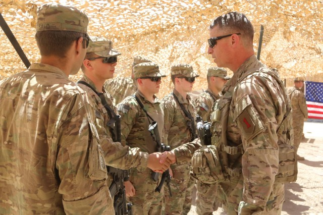 U.S. Army Maj. Gen. Joseph Martin, commanding general of Combined Joint Force Land Component Command and the 1st Infantry Division, greets Paratroopers at Hamam al-Alil, Iraq, June 8, 2017. The Paratroopers, deployed in support of Combined Joint Task Force-Operation Inherent Resolve and assigned to 2nd Brigade Combat Team, 82nd Airborne Division, enable their Iraqi security force partners through the advise and assist mission, contributing planning, intelligence collection and analysis, force protection, and precision fires to achieve the military defeat of ISIS. CJTF-OIR is the global Coalition to defeat ISIS in Iraq and Syria.