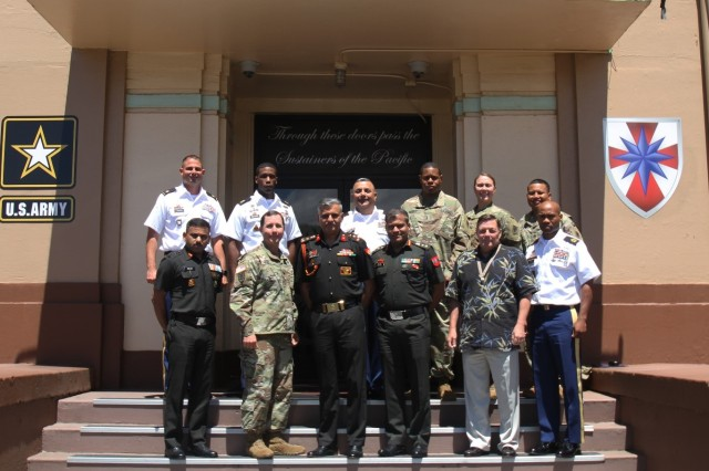 Indian Army Brigadier Paramvir Singh Sehrawat (center left), Col. Alok Dash (center right) and Col. Shiv Yadav (far left) of the Indian Army pose with Col. Stephen M. Howell (front left), 8th TSC Support Operations Officer and other logistical command sections within the 8th TSC. The Indian Army Subject Matter Expert Exchange took place May 15-18 and began with a meet and greet and an overall logistical brief including topics in Class III (B), Munitions and Watercraft Operations.
