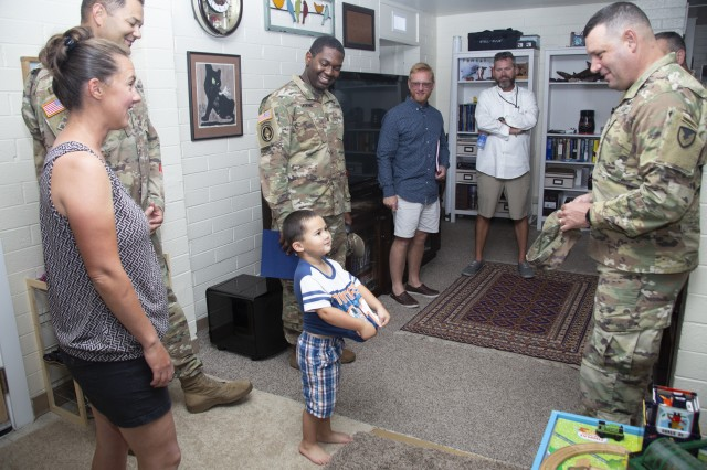 A member of the Stevens household greets USAG-KA Commander Col. James DeOre during a housing visit.