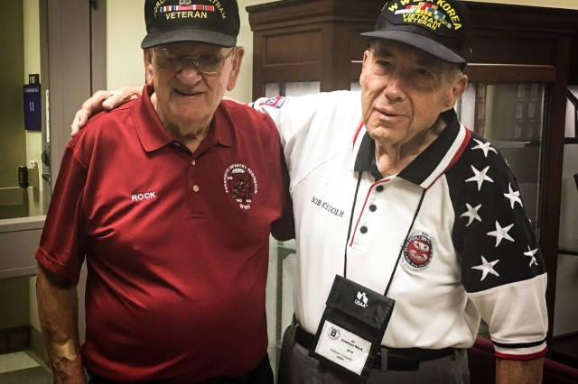 """Retired Command Sgt. Maj. Kenneth """"Rock"""" Merritt, left, and Retired Lt. Col. Bob Chisolm, right, pause for a photo May 20th, 2019 in the 3rd Brigade Combat Team, 82nd Airborne Division Headquarters on Fort Bragg, North Carolina.  Both are WWII Veterans of units in the 3rd Brigade Combat Team with Chisolm a veteran of the Korean and Vietnam Wars."""