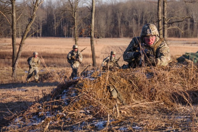 A paratrooper from the 1st Battalion, 508th Parachute Infantry Regiment, 3rd Brigade Combat Team, 82nd Airborne Division pulls security while others bound between cover during a live-fire exercise Jan. 27 at Camp Atterbury, Indiana.  The platoon-level live-fire exercise tested the paratroopers' ability to conduct complex operations in challenging terrain and frigid temperatures against a simulated near-peer enemy.