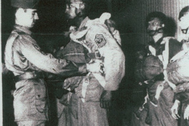 Then-1st. Sgt. Walter Morris, right, prepares for his first jump with the 555th Parachute Infantry Regiment.