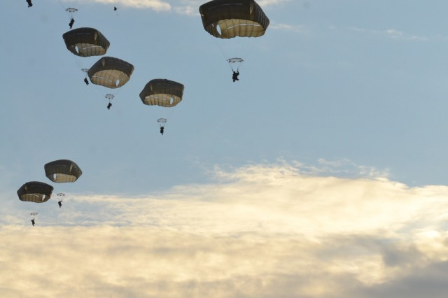 Paratroopers from the 3rd Brigade Combat Team, 82nd Airborne Division descend onto Fort Bragg's Normandy Drop Zone after jumping from a U.S. Air Force C-17 Globemaster on February 1, 2019.  The paratroopers conducted a combat equipment static line airborne operation onto the drop zone to maintain their proficiency and rehearse their roles during follow-on missions.