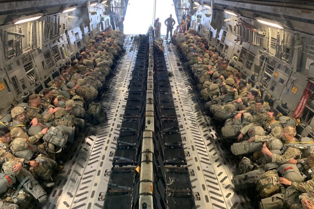 Paratroopers assigned to the 3rd Brigade Combat Team, 82nd Airborne Division wait after loading an Airforce C-17 Globemaster aircraft to conduct Operation Panther Storm on Thursday, March 28 at Fort Bragg's Pope Army Airfield.  Operation Panther Storm was a training exercise demonstrating the brigade's ability to jump, fight and win on any drop zone in the world.