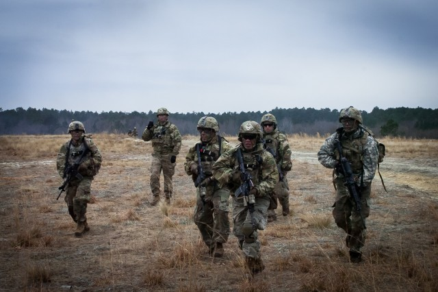 Paratroopers assigned to Company A, 1st Battalion, 505th Parachute Infantry Regiment, 3rd Brigade Combat Team, 82nd Airborne Division bound between buildings during the Company's live-fire exercise conducted February 19, 2019.
