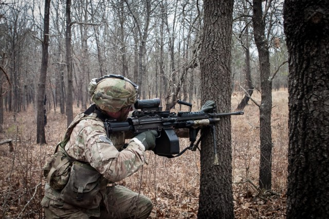 A paratrooper from Company A, 1st Battalion, 505th Parachute Infantry Regiment, 3rd Brigade Combat Team, 82nd Airborne Division engages targets during the Company's live-fire exercise conducted February 19 on Fort Bragg, North Carolina.