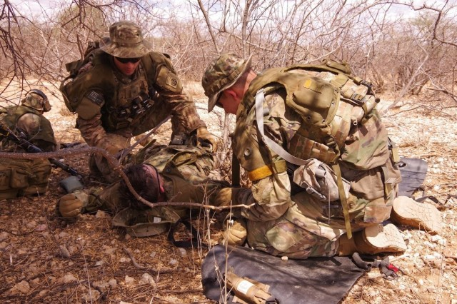 Paratroopers assigned to the 1st Battalion, 508th Parachute Infantry Regiment, 3rd Brigade Combat Team, 82nd Airborne Division provide emergency medical care to a simulated casualty during a live-fire exercise alongside British paratroopers from 2 PARA. 16 Air Assault Brigade on November 16, 2018 in Kenya Africa as part of Operation Askari Storm.   Askari Storm is an international partner training operation occurring in Kenya, Africa between elements of the U.S.' 82nd Airborne Division and the British 16 Air Assault Brigade designed to improve the readiness and interoperability of the participating forces as they conduct live-fire scenarios and exchange best tactical and maneuver practices.