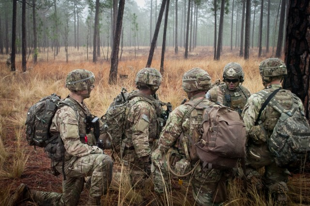 Paratroopers from Company C, 2nd Battalion, 505th Parachute Infantry Regiment, 3rd Brigade Combat Team, 82nd Airborne Division converge during their Company's live-fire exercise to determine how to attack a simulated enemy position Sunday, February 24 on Fort Bragg, North Carolina.