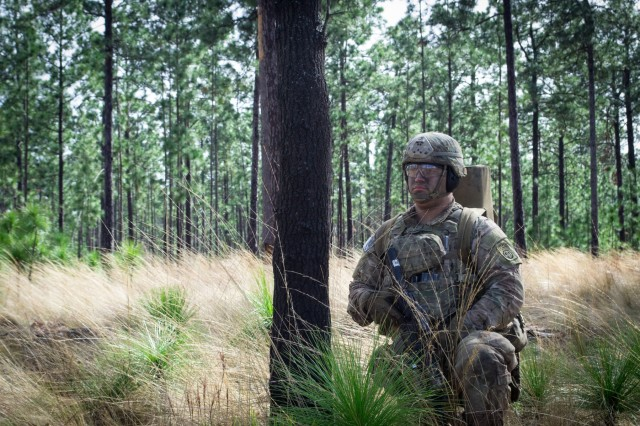 A paratrooper from Company C, 2nd Battalion, 505th Parachute Infantry Regiment, 3rd Brigade Combat Team, 82nd Airborne Division observes his surroundings during the Company's live-fire exercise held Sunday, February 24 on Fort Bragg, North Carolina.