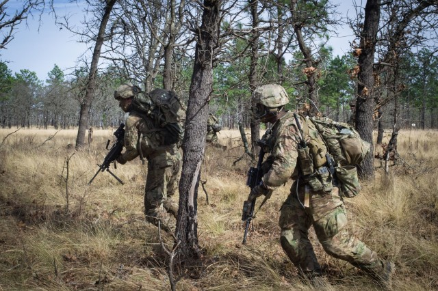 Paratroopers from Company C, 2nd Battalion, 505th Parachute Infantry Regiment, 3rd Brigade Combat Team, 82nd Airborne Division bound between cover during the Company's live-fire exercise held Sunday, February 24 on Fort Bragg, North Carolina.