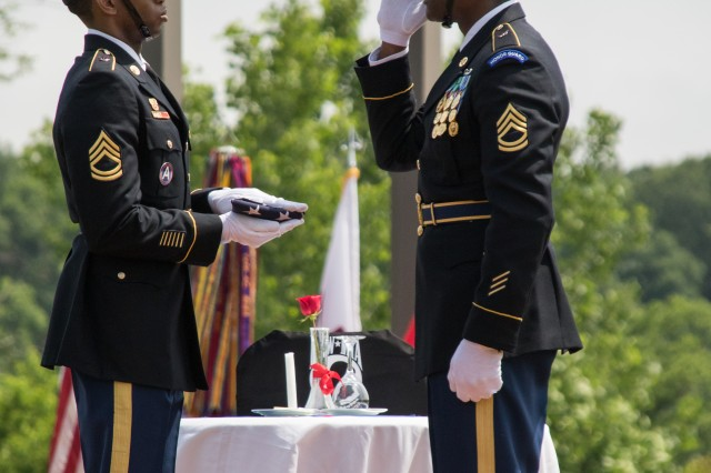 Soldiers from the U.S. Army Human Resources Honor Guard conduct a flag folding ceremony during the Memorial Day ceremony at Kentucky Veterans Cemetery-Central in Radcliff, Kentucky.