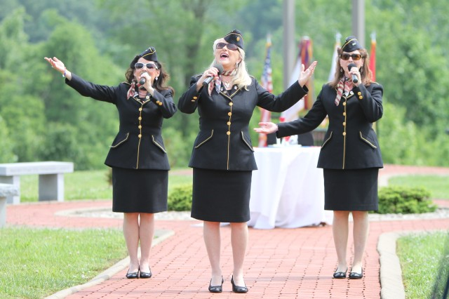 The Ladies for Liberty performs a variety of patriotic music before the official start of the Memorial Day ceremony at Kentucky Veterans Cemetery-Central in Radcliff, Kentucky.