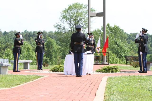 Members of the U.S. Army Human Resources Command Honor Guard render a salute, honoring U.S. prisoners of war and missing in action.