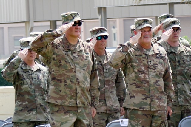 """Maj. Gen. Flem B. """"Donnie"""" Walker,  commanding general of the 1st Theater Sustainment Command, and Brig. Gen. Clint E. Walker, commanding general of the 184th Sustainment Command, salute during the Memorial Day service held at Camp Arifjan, Kuwait, May 27, 2019. (U.S. Army National Guard photo by Staff Sgt. Veronica McNabb)"""
