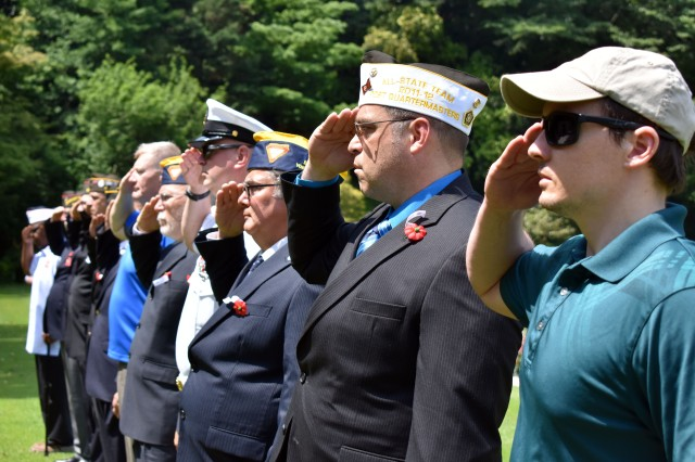 Veterans of Foreign Wars and military representatives salute during the Veterans of Foreign Wars of the U.S. Department of Pacific Areas, District 2 Mainland Japan Memorial Day Observance 2019 at the Yokohama War Cemetery in the Hodogaya Ward of Yokohama, Japan, May 26.