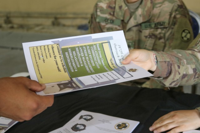 An informational flyer is handed out during a resiliency fair hosted by the 1972d Medical Detachment at Camp Arifjan, Kuwait, May 25, 2019. The 1972d is a U.S. Army Reserve unit that provides direct support combat and operational stress control (COSC) prevention and treatment services. (U.S. Army National Guard photo by Staff Sgt. Veronica McNabb)