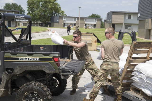 Oklahoma Army National Guard Soldiers from Company B, 1st Battalion, 279th Infantry Regiment, deliver sandbags to flood-stricken areas of Northeastern Okla., May 25, 2019. Oklahoma Army National Guard Soldiers assisted several Oklahoma communities following record rain fall and numerous tornados. The Guardsmens' assistance included swift water rescue, filling and distributing sandbags and delivering purified, potable water.