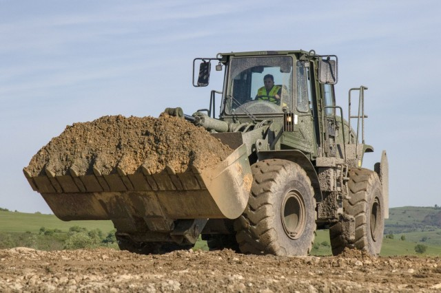 Alaska Army National Guard Spc. Charlie Reyes, 207th Engineer Utility Detachment, operates a dump truck at Cherry Hill, Cincu, Romania, as part of exercise Resolute Castle 2019, May 12. Resolute Castle is a multi-national, joint exercise with real-world outputs of completed construction projects that build and enhance training capabilities around Eastern Europe.