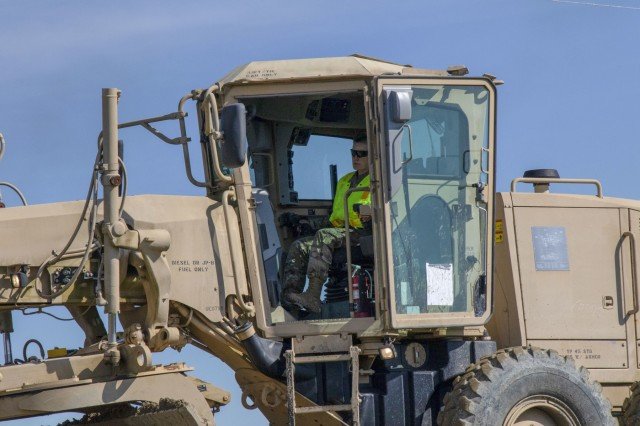 Alaska Army National Guard Spc. Angela Dyerhatfield, 207th Engineer Utility Detachment, operates a grader during Resolute Castle 2019 at Cincu, Romania, May 12. Resolute Castle is a multi-national, joint exercise with real-world outputs of completed construction projects that build and enhance training capabilities around Eastern Europe.