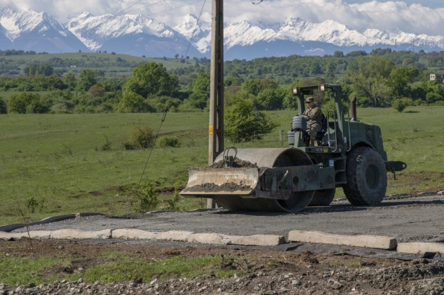 Alaska Army National Guard Spc. Jeremy Weller, 207th Engineer Utility Detachment, operates a roller during exercise Resolute Castle 2019 in Cincu, Romania, May, 12. Resolute Castle is a multi-national, joint exercise with real-world outputs of completed construction projects that build and enhance training capabilities around Eastern Europe.