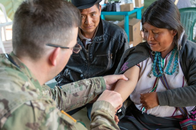 Maj. Adam White, a doctor assigned to the Missouri National Guard Medical Detachment, provides medical care to a San Sebastián, Huehuetenango, Guatemala, resident May 20, 2019 during a medical readiness training exercise during Beyond the Horizon, 2019. Guatemala Ministry of Public Health, U.S. Forces, Florida International University non-governmental organization, Guatemala Ministry of Social Services and Guatemalan forces provided medical, dental and pharmaceutical care to more than 3,700 San Sebastián residents at the Beyond the Horizon 2019 medical readiness training exercise May 20-24, 2019. Beyond the Horizon is an annual exercise designed to build partner nation capacity for civil and military response to major disasters and the relationships built and sustained through this exercise demonstrate the ability of the U.S., and regional partners, to access and execute disaster relief activities throughout Central America.
