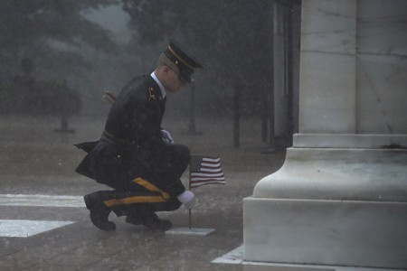 A Soldier of the 3rd U.S. Infantry Regiment (The Old Guard), plants a U.S. flag in front of the Tomb of the Unknown Soldier during a severe storm for Flags In at Arlington National Cemetery, May 23, 2019. Flags In is an annual military operation carried out by The Old Guard before Memorial Day weekend in which Soldiers plant over 245,000 U.S. flags at the graves of Arlington National Cemetery.