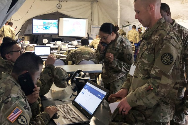 Soldiers of the 369th Sustainment Brigade man their command post on May 12, 2019, during exercise Guardian Response 19 at Camp Atterbury, Indiana. One hundred and sixty New York National Guard Soldiers took part in the major national exercise.