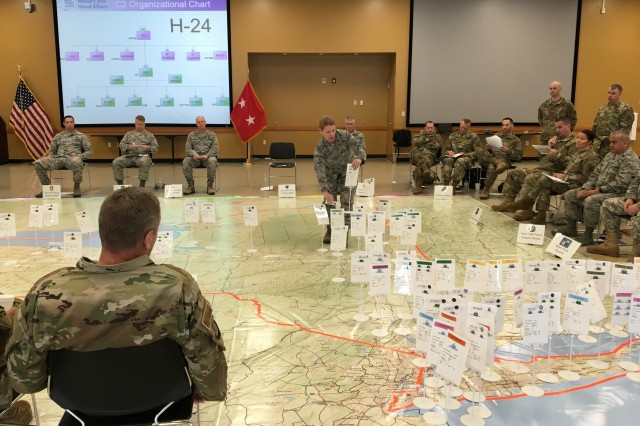 New York Air National Guard Lt. Col. Tammy Street, center, commander of the logistics readiness squadron of the 109th Airlift Wing, moves a placard representation of a wing response element during the rehearsal of New York military forces plan for a coastal storm during the 2019 hurricane season at the Armed Forces Reserve Center in New Windsor, N.Y., May 23, 2019. The gathering of some 80 commanders and staffs from across the joint force presented the state plan of response during a potentially catastrophic storm arriving along New York's coast. The rehearsal was part of a four-day training workshop for civil support operations.