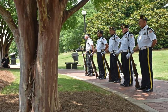 American Legion Post 237 rifle squad members render honors at the Memorial Day Commemoration at Veterans Memorial Park, May 27, 2019.