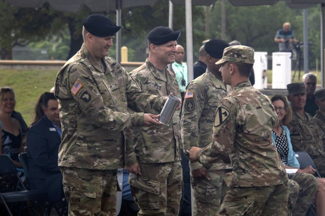 "Outgoing U.S. Army Operational Test Command Commander Brig. Gen. William D. ""Hank"" Taylor receives the last cannon round fired during honors from Pvt. Stunner Taylor (no relation), a Soldier with Bravo Battery, 3-16th Field Artillery, 1st Cavalry Division, during change of command ceremonies May 23. Taylor is moving on to become Senior Advisor to the Ministry of Defense, U.S. Forces-Afghanistan, Operation Freedom's Sentinel, Afghanistan."