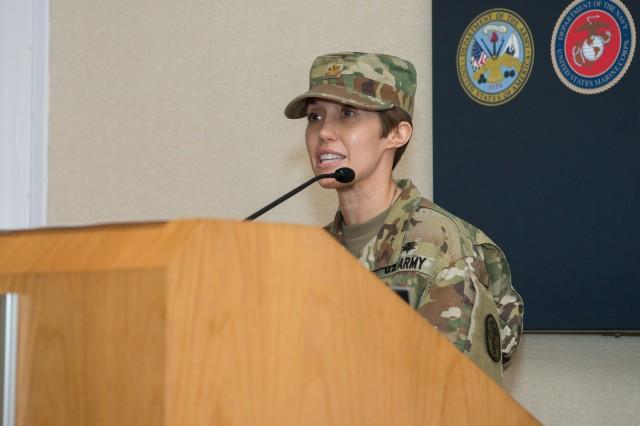 Outgoing APHC HHC commander Maj. Diana Rommelfanger-Konkol speaks during APHC's HHC Change of Command Ceremony April 9.