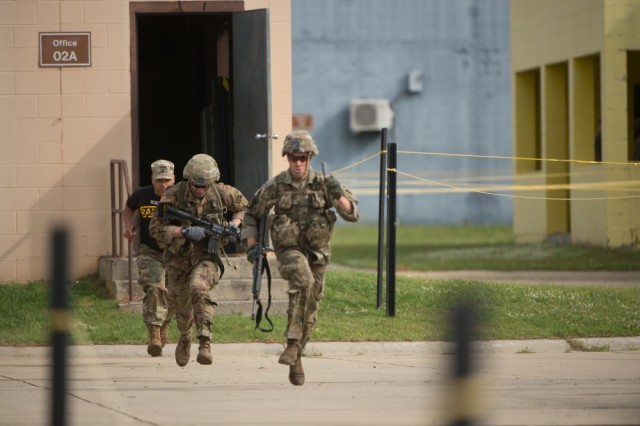 Members of the 4th Infantry Division run from one building to another at Selby Combined Arms Collective Training Facility on Fort Benning, Ga., during the 36th Best Ranger Competition in April. Army installations have become more vulnerable, said Lt. Gen. Gwen Bingham, assistant chief of staff for installation management. In order to better protect Army posts worldwide, senior Army leaders said that the service will consider using smart technology to bolster security and enable commanders to respond to threats swiftly.