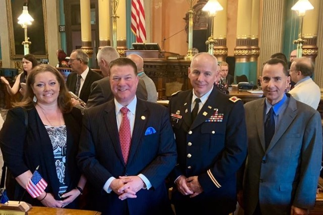 On the Senate floor (from left to right):  Detroit Arsenal SOS Coordinator Jenny Downey, State Senator Peter Lucido, TACOM Chief of Staff Col. Jeffrey Witt, and Detroit Arsenal Garrison Manager Joseph Moscone.
