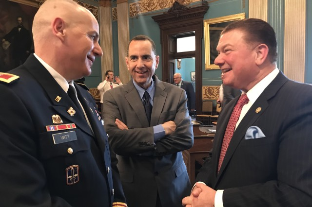 TACOM Chief of Staff Col. Jeffrey Witt, Detroit Arsenal Garrison Manager Joseph Moscone, and State Senator Peter Lucido on the Senate floor.