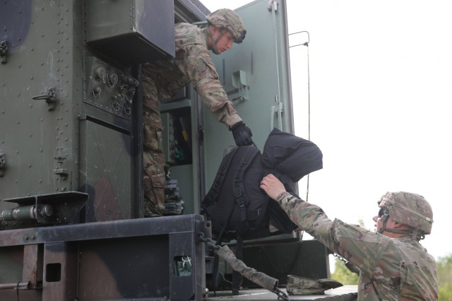 U.S. Soldiers from the 5th Battalion 7th Air Defense Artillery Regiment unload equipment from vehicles as they prepare to kick off exercise Astral Knight 19 in Koper, Slovenia May 28 2019. AK 19 is a multinational combined exercise designed to test integrated air and missile defense capabilities. U.S. Army photo by Sgt. Erica Earl