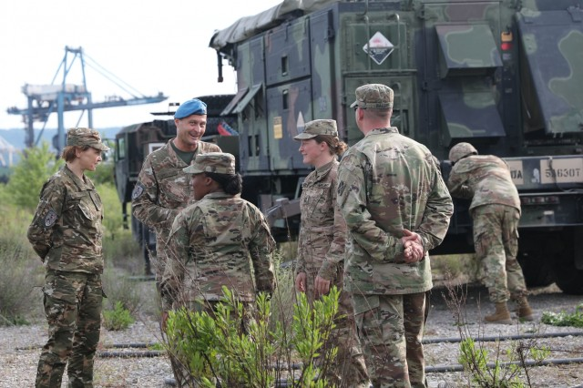 U.S. Soldiers from the 5-7 Air Defense Artillery Battalion meet with Slovenian soldiers as they set up for Astral Knight 19 in Koper, Slovenia May 28, 2019. AK 19 is a multinational combined exercise designed to test integrated air and missile defense capabilities. U.S. Army photo by Sgt. Erica Earl