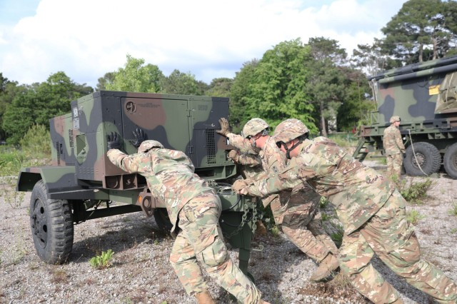 U.S. Soldiers from the 5th Battalion 7th Air Defense Artillery Regiment move equipment as they prepare to kick off exercise Astral Knight 19 in Koper, Slovenia May 28 2019. AK 19 is a multinational combined exercise designed to test integrated air and missile defense capabilities. U.S. Army photo by Sgt. Erica Earl