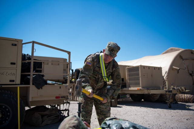 Idaho Army National Guard Capt. Micheal Winchester, a JAG officer with 116th Cavalry Brigade Combat Team, helps set up the Tactical operations center May 25, 2019, at the National Training Center at  Fort Irwin, Calif. The 116th Cavalry Brigade Combat Team is training at the NTC from 24 May to 20 June to prepare for its wartime missions.