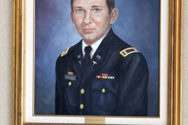 A painting of 1st Lt. Kenneth Shoemaker Jr. hangs in the entrance to the headquarters building, along with a plaque that identifies his service to the nation.