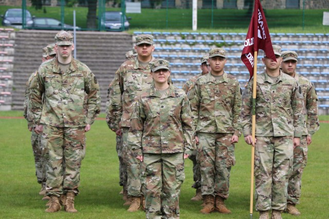 U.S. Army Lt. Col. Elizabeth Gum, center, stands at attention with Soldiers of the U.S. Army Health Clinic Baumholder during the clinic's change of command ceremony May 28.