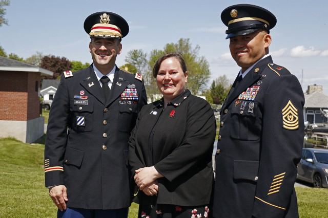 Lt. Col. James Beaulieu (left), and Command Sgt. Maj. Mark Millare (right), command team of the 41st Engineer Battalion, 2nd Brigade Combat Team, 10th Mountain Division, pose for a photo alongside Molly Reilly, Sackets Harbor mayor, following the village's annual Memorial Honors, hosted by American Legion Post 1757, May 27, 2019, in Sackets Harbor, New York. Beaulieu spoke during the ceremony honoring members of the U.S. Armed Forces. American Legion members gave the local U.S. Coast Guard a wreath to place in the Black River Bay during the ceremony and performed a 21-gun salute. A local student of Sackets Harbor Central School concluded the ceremony by playing Taps on a trumpet. (U.S. Army photo by Staff Sgt. Paige Behringer)