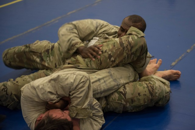 Sgt. Tyler Poston, 61st QM Battalion, tries to secure an armbar as Sgt. Robert West positions himself to maneuver out of the attempt.  Soldiers from the 13th competed in the Best Warrior Competition May 20-23, where Poston won the combatives event and also earned the right to compete at the III Corps level next month.  (U.S. Army photo by Sgt. 1st Class Kelvin Ringold)