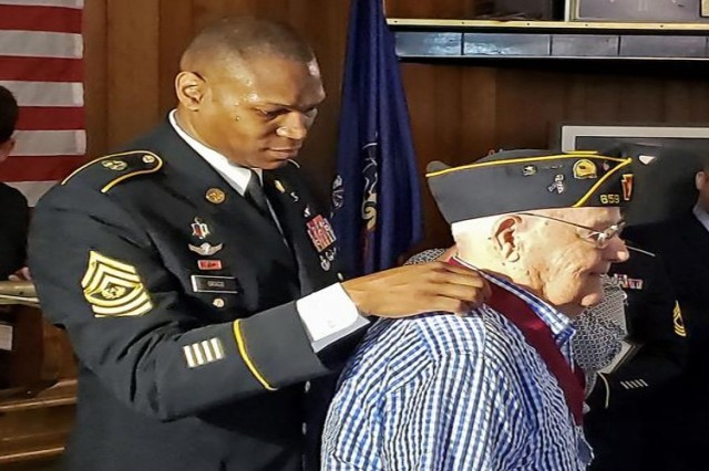 Command Sgt. Maj. Michael Gragg (left) of the Army Medical Command traveled to Belle Vernon, Pennsylvania, on May 28, the hometown of Staff Sgt. (ret.) Felix J. Lisovich, a 96-year-old World War II combat medic.  Gragg presented Lisovich with a Regimental Honor Certificate, the Order of Military Medical Merit, and a letter of recognition signed by Lt. Gen. Nadja Y. West, Army Surgeon General and Commanding General, U.S. Army Medical Command.  Lisovich was a combat medic on Luzon in the Philippines.  During his tour of duty, he served as a surgical technician in the Pacific Theater with Medical Detachment 2nd Battalion, 172th Infantry Regiment, 43rd Infantry Division.  Lisovich earned the Combat Medic Badge, Bronze Star, Purple Heart, and other campaign medals and citations.