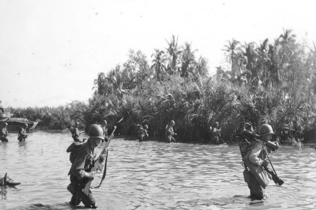 Army file photo of soldiers on Luzon in the Philippines.  U.S. Forces engaged the Japanese from January 1945 until Japan's surrender in August.  They faced kamikaze attacks from Japanese Zero fighter planes, participated in the amphibious landings during the invasion of Luzon; patrolled the jungle; and often suffered from a range of diseases, especially malaria.